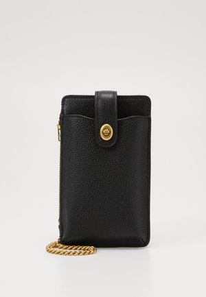 TURNLOCK CHAIN PHONE CROSSBODY - Phone case - black