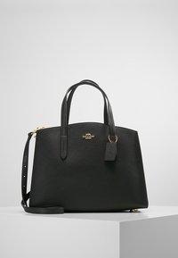 Coach - CHARLIE CARRYALL - Handbag - black - 0