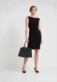Coach - CHARLIE CARRYALL - Handbag - black - 1