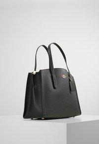 Coach - CHARLIE CARRYALL - Handbag - black - 3