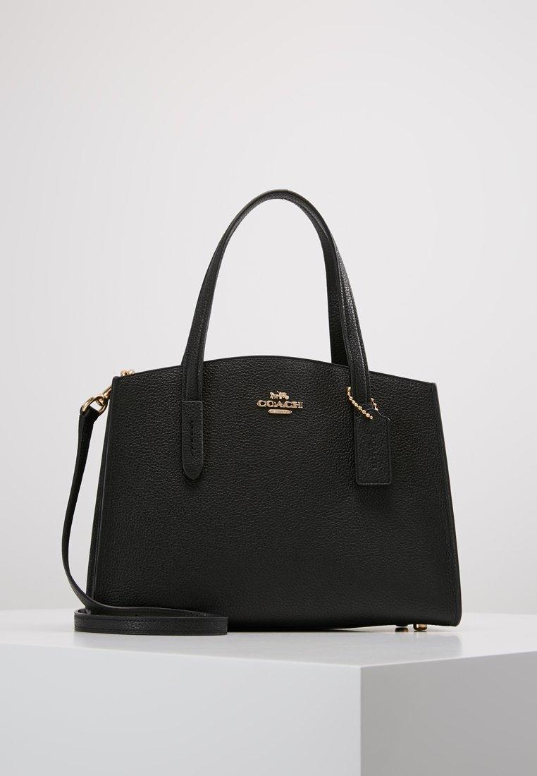 Coach - CHARLIE CARRYALL - Handbag - black