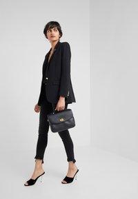 Coach - POLISHED PEBBLED BLAISE CROSSBODY - Handbag - black - 1