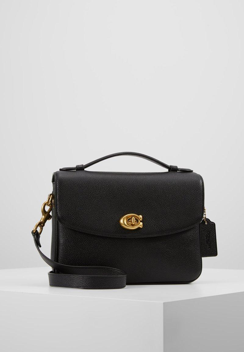 Coach - POLISHED PEBBLED BLAISE CROSSBODY - Handbag - black