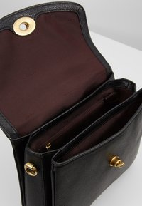 Coach - POLISHED PEBBLED BLAISE CROSSBODY - Handbag - black - 4