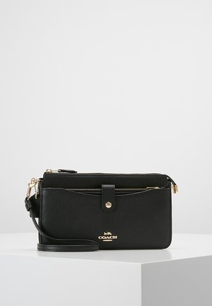 POLISHED PEBBLE POP UP MESSENGER - Pikkulaukku - black