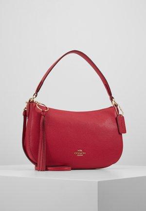 POLISHED SUTTON CROSSBODY - Handbag - bright cherry
