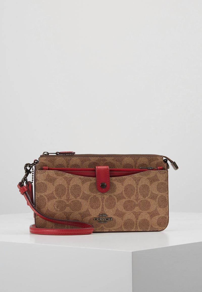 Coach - NOA - Across body bag - tan/red apple