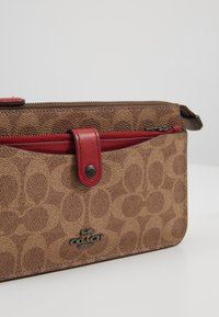 Coach - NOA - Across body bag - tan/red apple - 7