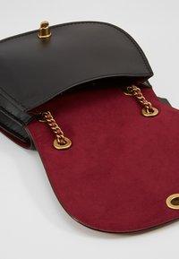 Coach - COATED SIGNATURE PARKER SADDLE BAG - Across body bag - tan rust - 4