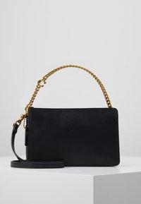 Coach - SIGNATURE CHAIN CROSSBODY - Handbag - black - 0
