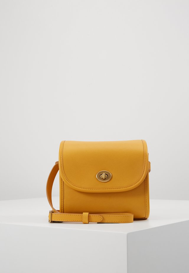 RUNWAY COACH ORIGINALS - Across body bag - buttercup