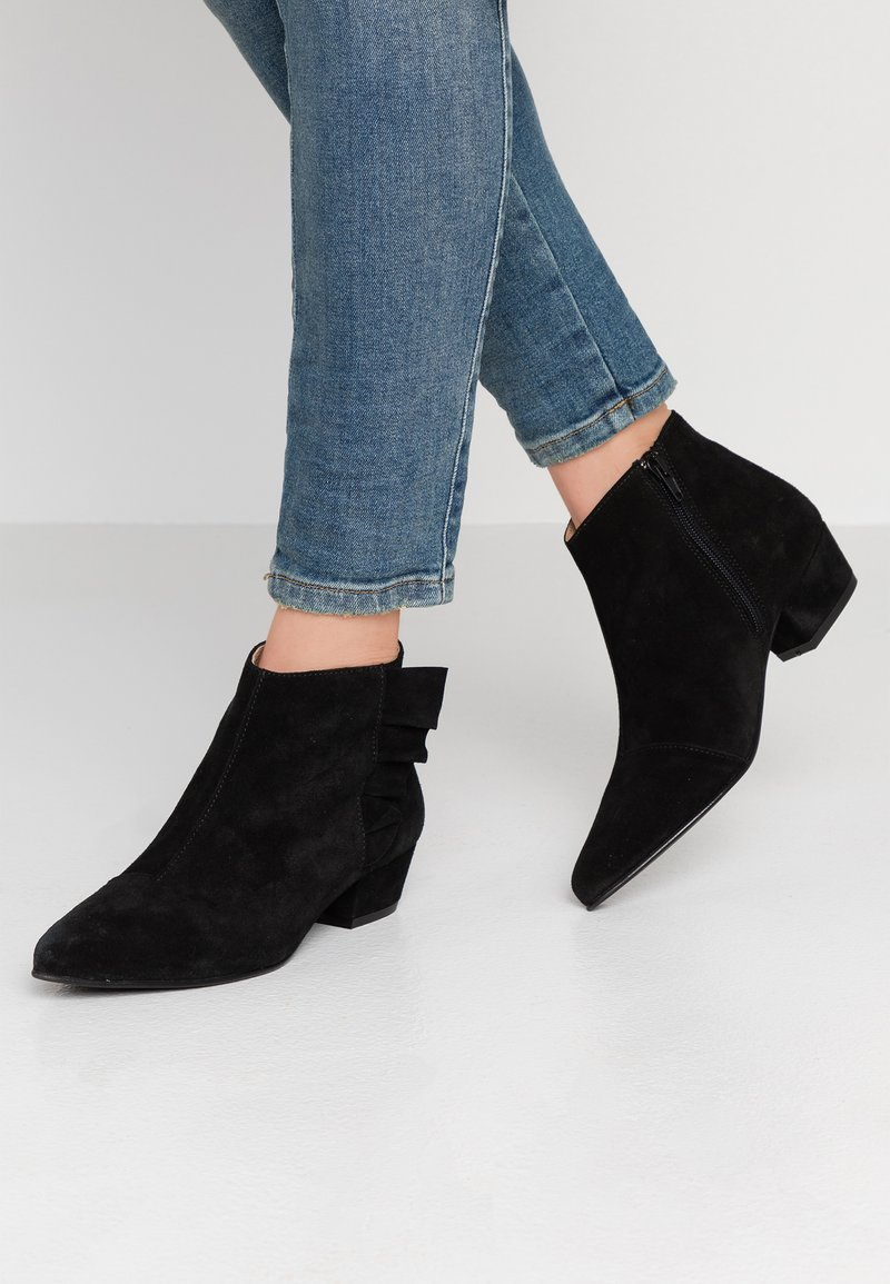 Cream - Ankle boots - pitch black