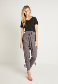 Cream - NANNA PANTS - Trousers - pitch black - 1