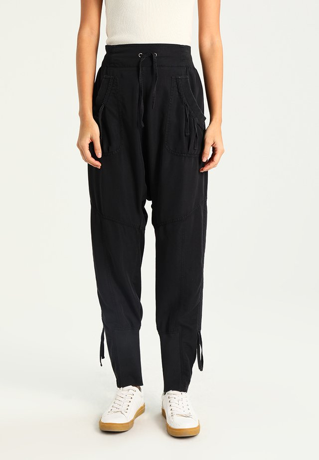 NANNA PANTS - Trousers - solid black