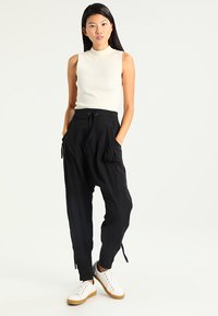 Cream - NANNA PANTS - Trousers - solid black - 1