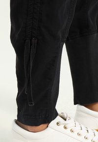 Cream - NANNA PANTS - Trousers - solid black - 4