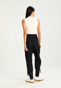 Cream - NANNA PANTS - Trousers - solid black - 2