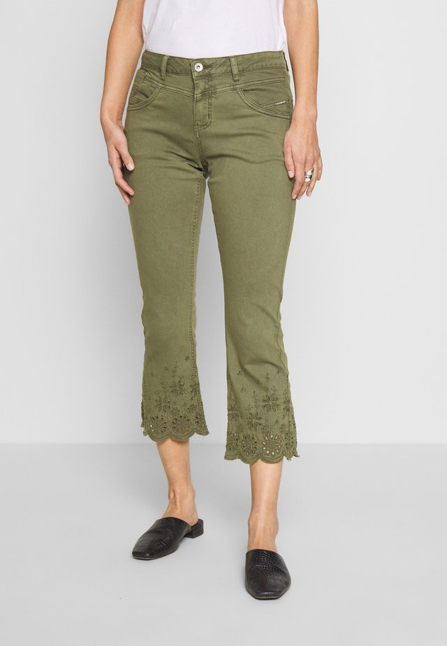 Flared jeans - burnt olive