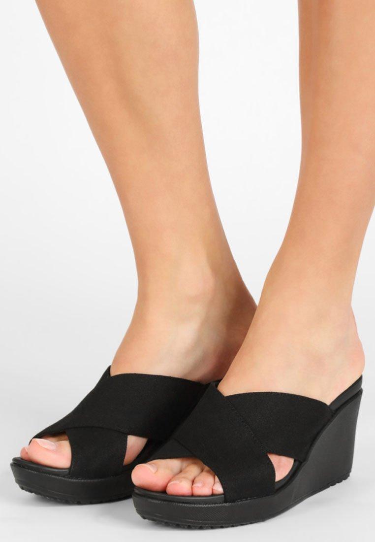 Crocs - LEIGH II CROSS-STRAP WEDGE - Heeled mules - black