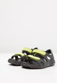 Crocs - SWIFTWATER RIVER RELAXED FIT - Pool slides - black/volt green - 3