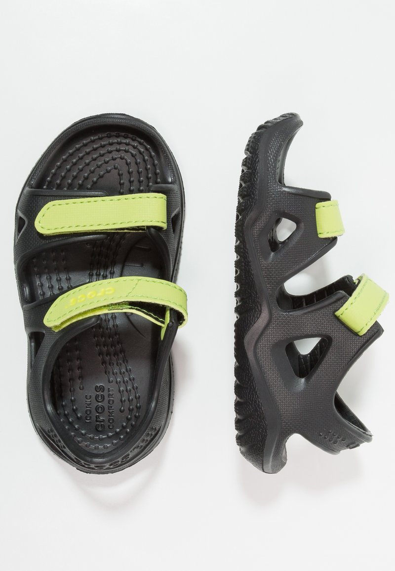 Crocs - SWIFTWATER RIVER RELAXED FIT - Pool slides - black/volt green