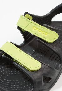 Crocs - SWIFTWATER RIVER RELAXED FIT - Pool slides - black/volt green - 2