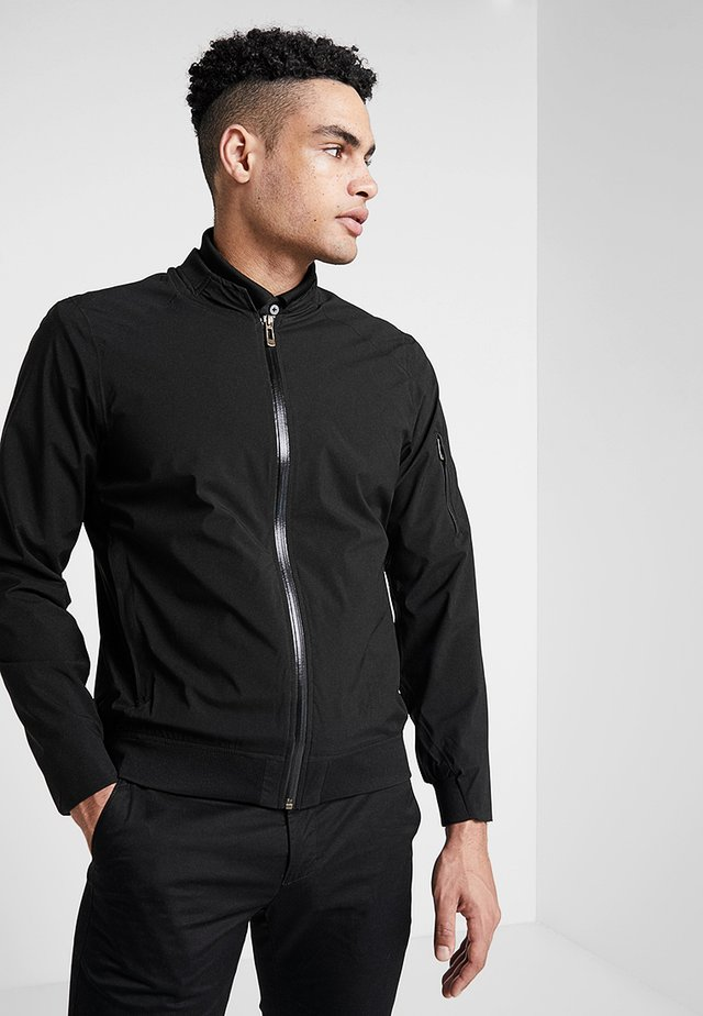 BOMBER JACKET - Waterproof jacket - black