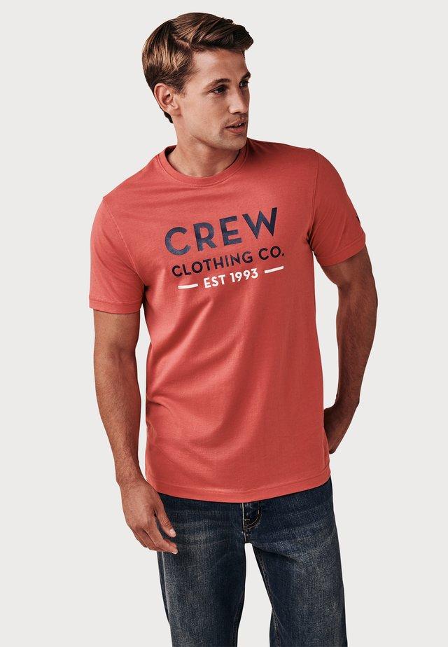 TILMORE  - T-shirt print - salmon