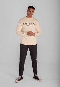 Crystal Paris - Sweatshirt - white sand - 1