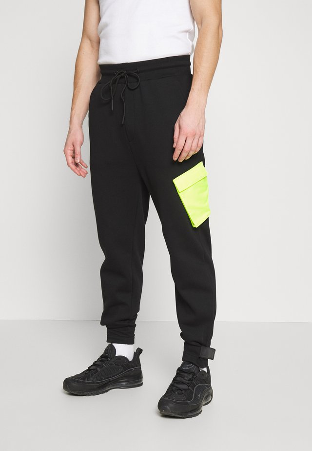 Pantalon de survêtement - black/volt