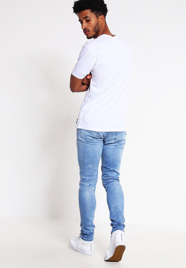 Cayler & Sons Jeans fuselé distressed light bluewhite