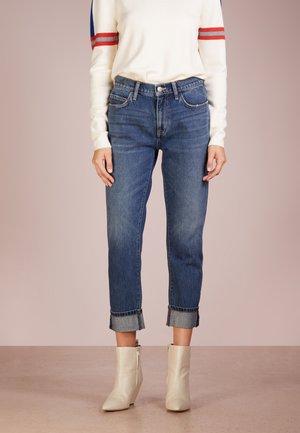 THE FLING - Slim fit jeans - year worn rigid indigo