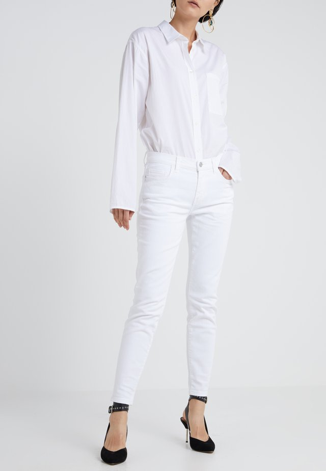 THE STILETTO - Jeans Skinny - white denim