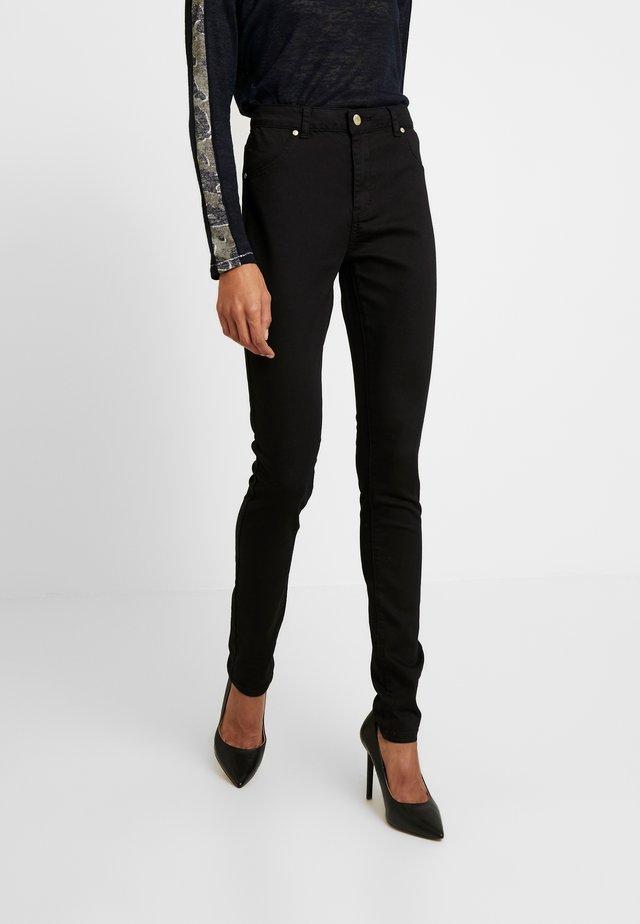 CUASTA PANTS - Trousers - black