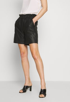 ALINA - Leather trousers - black