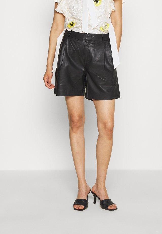 MAHIAM - Leather trousers - anthracite black