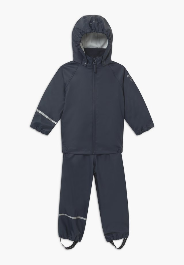 BASIC RAINWEAR RECYCLE SET - Rain trousers - dark navy