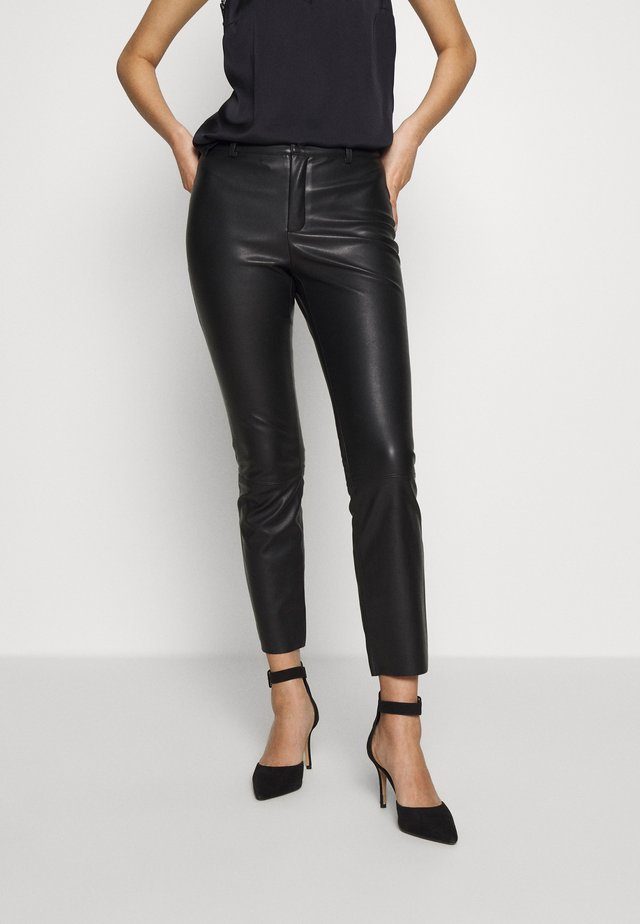 TROUSERS KAVEH - Stoffhose - black