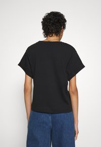 Carin Wester - STORM - T-shirts - black - 2