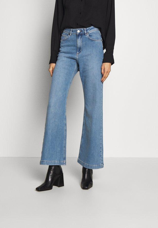 TROUSERS FAIZA - Flared Jeans - light denim blue