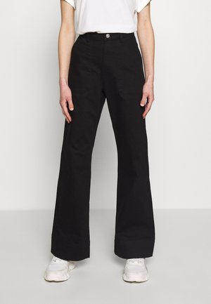 FARZAD - Flared jeans - black