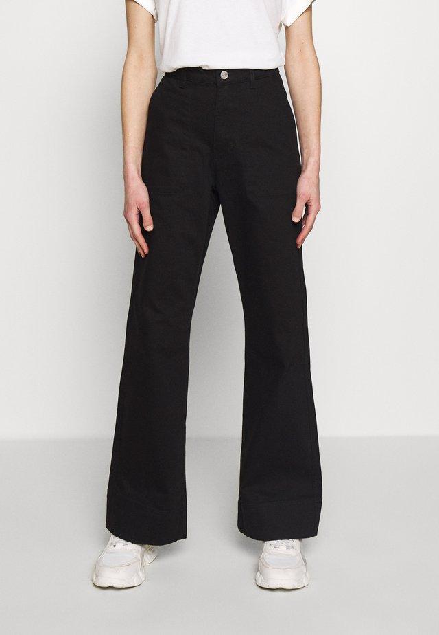 FARZAD - Flared Jeans - black