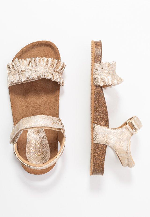 Sandaalit nilkkaremmillä - lagos oro