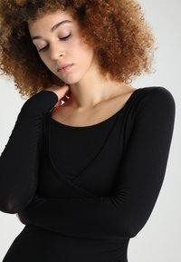Curare Yogawear - Topper langermet - black - 3