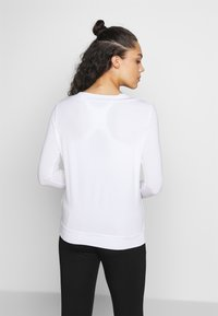 Curare Yogawear - Long sleeved top - white - 2