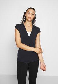 Curare Yogawear - T-shirt basic - midnight blue - 0