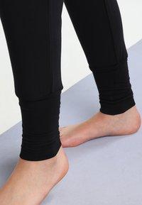 Curare Yogawear - Træningsbukser - black - 3