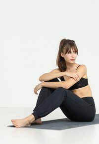 Curare Yogawear - LONG PANTS ROLL DOWN - Tracksuit bottoms - midnight/blue - 1
