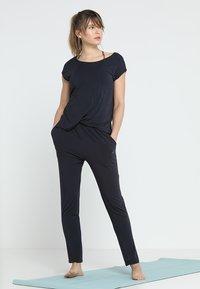 Curare Yogawear - ONEPIECE  - Trainingsanzug - midnight blue - 0