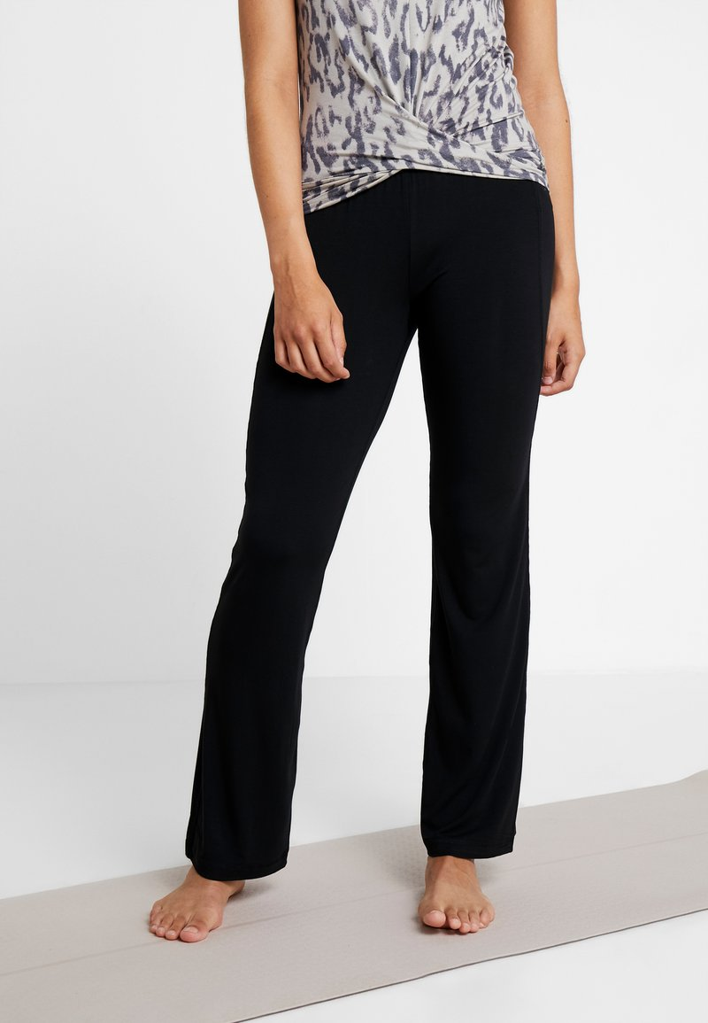 Curare Yogawear - PANTS FLARED LEGS - Tracksuit bottoms - black